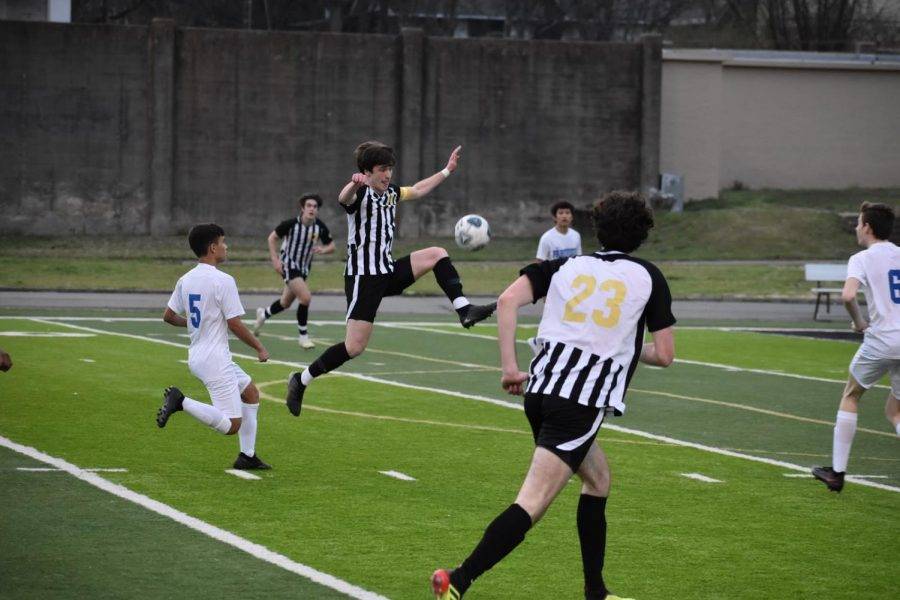 Senior Jonathan Coulter jumps to defend the ball. Coulter was the team captain for the game. Photo by Anna Yates