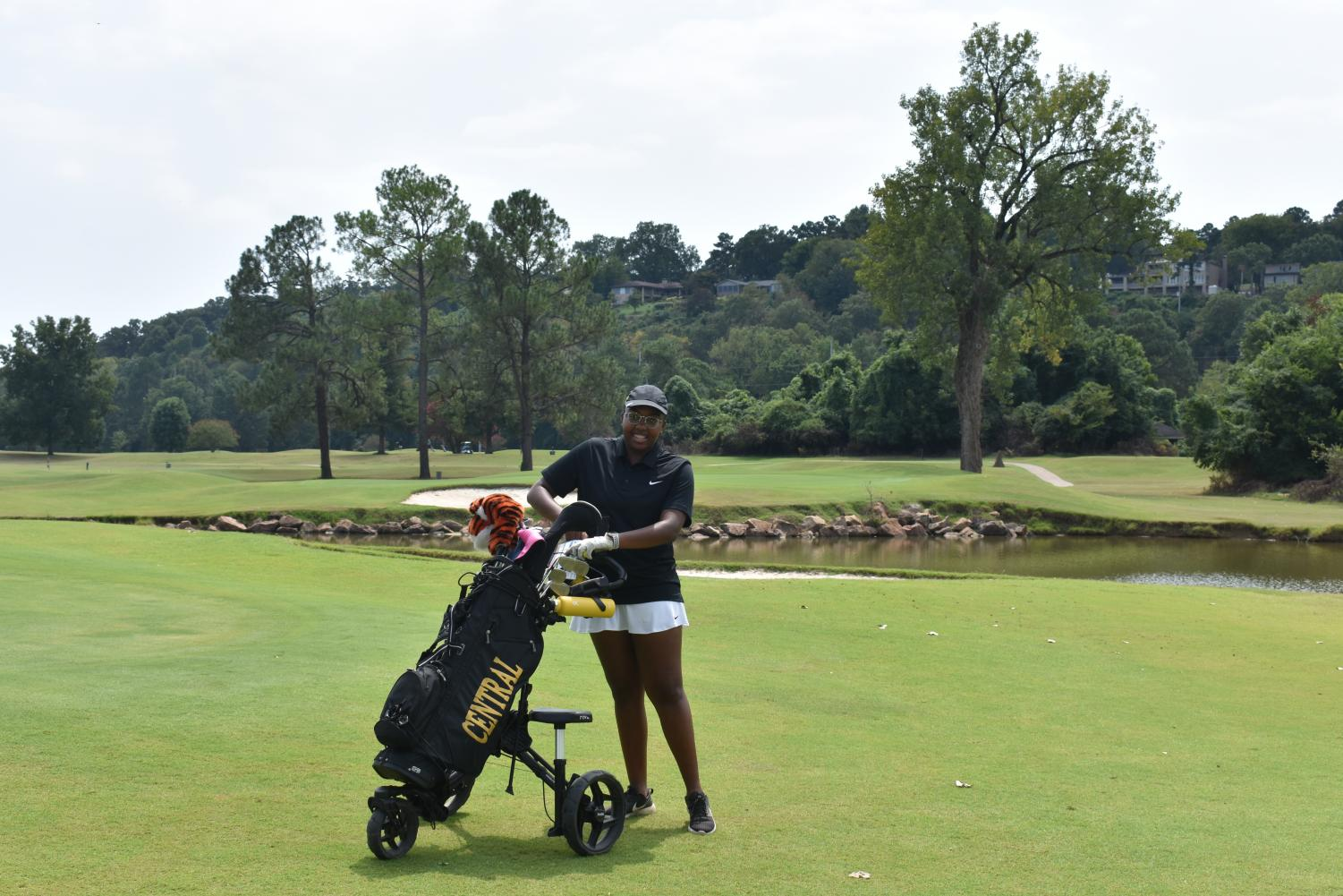 Kayln Pendelton puts her club away and gets ready to head to the next hole at the Rebsamen. Pendelton won first place overall at the Jaycees Golf tournament on Aug. 30.