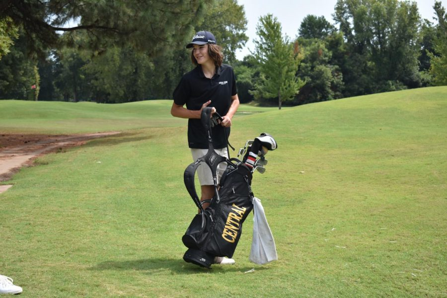 Senior Will Roberson leaves the field after an easy shot at Rebsamen Golf Course, Sept. 2. The ladies and men's teams both competed.