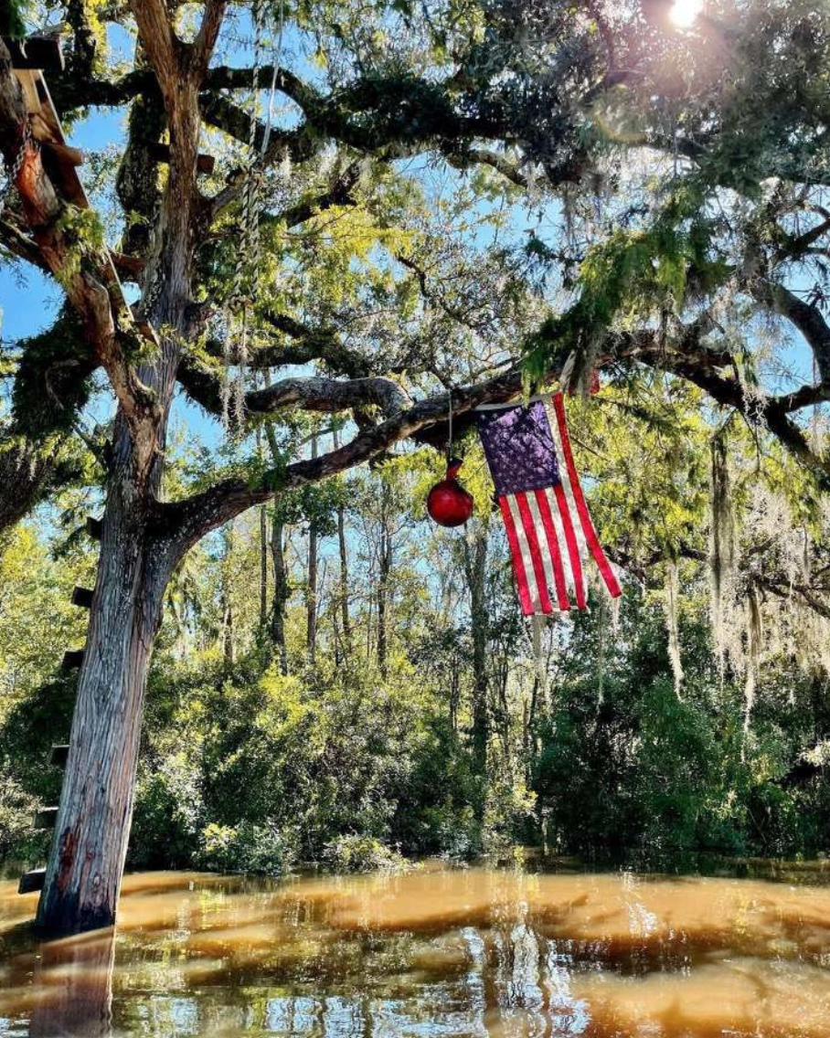 A rope swing on the Tchefuncte River is strung up in the limbs after Hurricane Ida blew through Louisiana. The photo shows the water level five feet high. Photo by Jackson Lanaux
