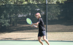 Freshman Caden Highfill prepares to hit the ball back to his opponent from Bryant High School at Rebsamen Tennis Centre.