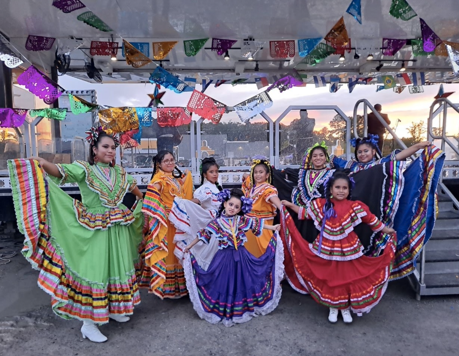 The folkloric dance team poses for a picture at a Hispanic Heritage event in Southwest Little Rock.